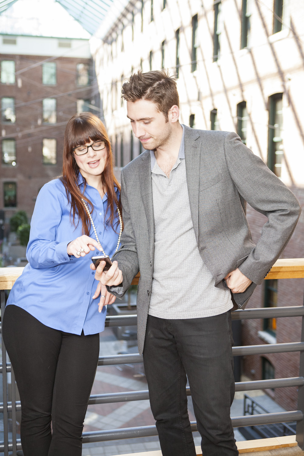 Woman and Man on Mobile Phone | Hypertargeting for PPC Success: Mobile Device Targeting